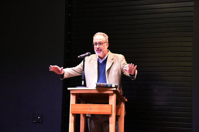 """Author James Mustache gives a talk on his newly -released book, """"1000 Books to read Before You Die"""". (Kush Kamar/ The Daily Campus)"""