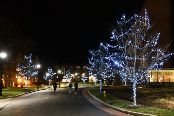 Festive lights are hanging on the trees all around campus for students to get in the holiday spirit. (Julie Spillane/The Daily Campus)
