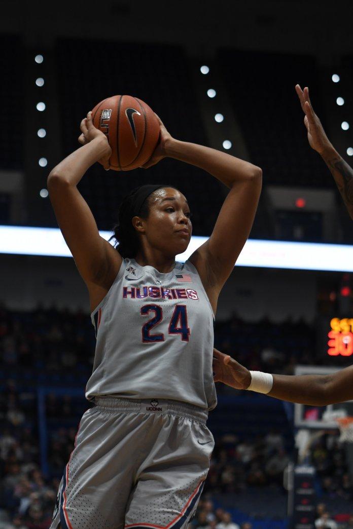 Napeesha Collier looks to pass. (Judah Shingleton/ The Daily Campus)