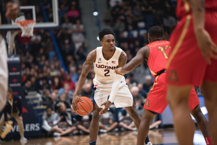 Tarin Smith looks for an avenue to pass during UConn's 76-72 loss to Arizona on Dec. 2, 2018. (Charlotte Lao/ The Daily Campus)