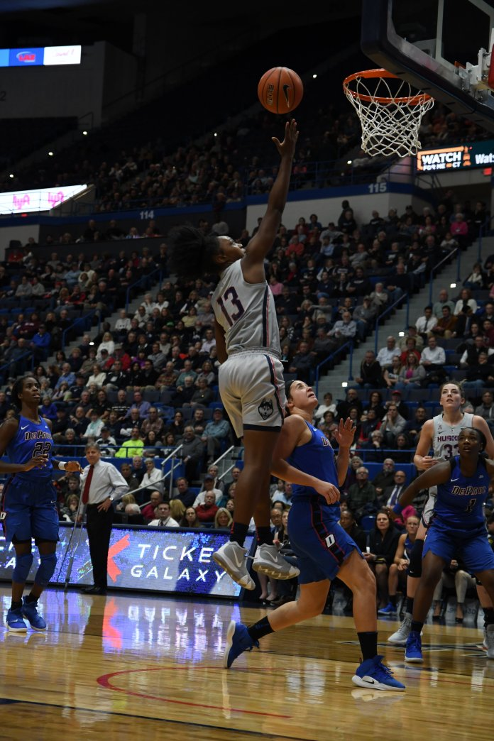 Freshman Christyn Williams drives to the hoop against DePaul opponents during a game on Wednesday, Nov. 28 at the XL Center. (Judah Shingleton, Staff Photographer/The Daily Campus)