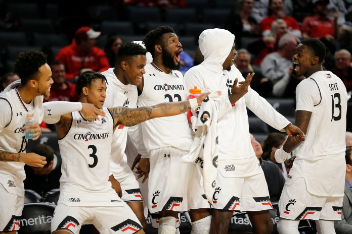 The Cincinnati Bearcats bench reacts after forward Mamoudou Diarra scores from 3-point range in a game against Arkansas-Pine Bluff on Tuesday, Nov. 27 in Cincinnati. (Sam Greene/The Cincinnati Enquirer via AP)