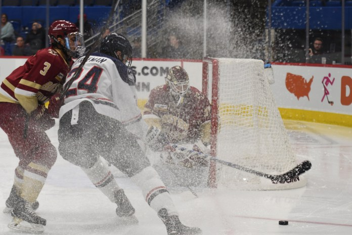Benjamin Freeman drives the puck but the UConn offense was held scoreless in a loss against Boston College (Judah Shingleton/The Daily Campus)