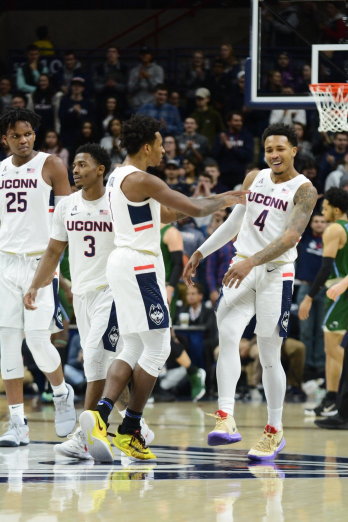 Christian Vital celebrates with teammate Jalen Adams. Vital scored 18 points and became the 51st Husky to reach the 1,000 point club, and Adams scored 31 points in UConn's win over Tulane. (Eric Wang/The Daily Campus)