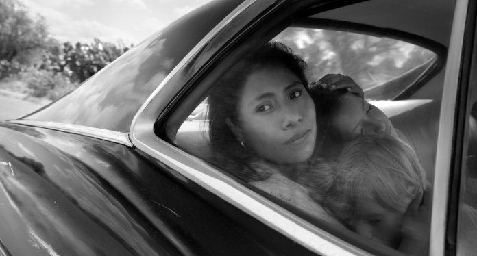 """This image released by Netflix shows Yalitza Aparicio in a scene from the film """"Roma,"""" by filmmaker Alfonso Cuaron. Aparicio portrays Cleo, a domestic worker who works for a woman whose husband abandons her and their four children. (Alfonso Cuarón/Netflix via AP)"""
