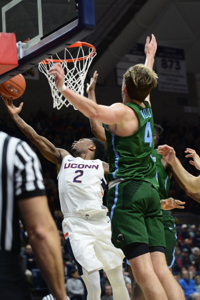 Tarin Smith rises up for a lay-up in UConn's game against Tulane. (Eric Wang/The Daily Campus)