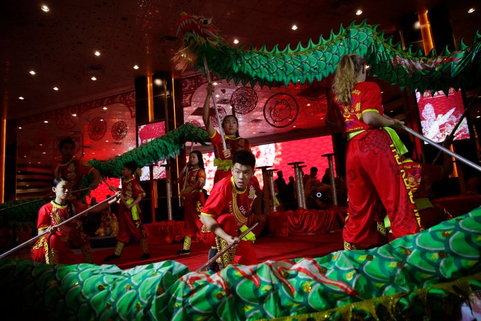 Dancers perform traditional lion and dragon dances at the MGM Grand Hotel and Casino to celebrate the Lunar New Year, Tuesday, Feb. 5, 2019, in Las Vegas. In recent years, the holiday, which people are ringing in Tuesday, has achieved all-American status. Big companies are celebrating - and capitalizing - on a holiday that is about being with loved ones and wishing for prosperity and good luck. (AP Photo/John Locher)
