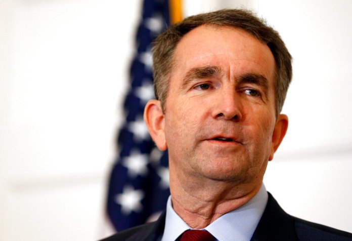 FILE - In this Feb. 2, 2019 file photo, Virginia Gov. Ralph Northam speaks during a news conference in the Governor's Mansion in Richmond, Va. Northam clung to his office Tuesday, Feb. 5, amid intense political fallout over a racist photo in his 1984 medical school yearbook and uncertainty about the future of the state's government. (AP Photo/Steve Helber, File)
