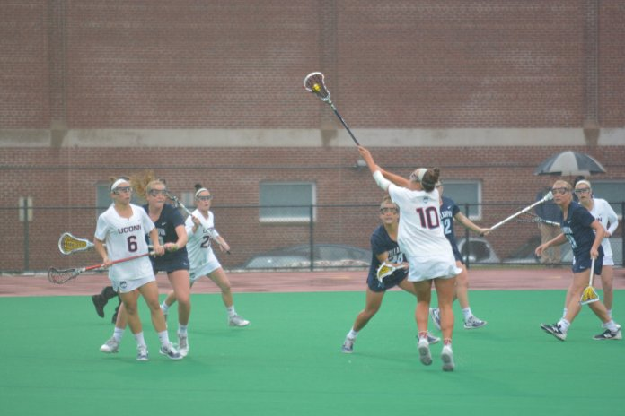 UConn's women lacrosse team opened up in the Carrier Dome. (Nick Hampton/The Daily Campus)