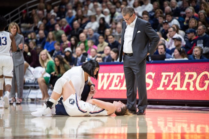 Senior Katie Lou Samuelson went down in pain after diving for a loose ball. The team is confident she will be back shortly. (Charlotte Lao/The Daily Campus)