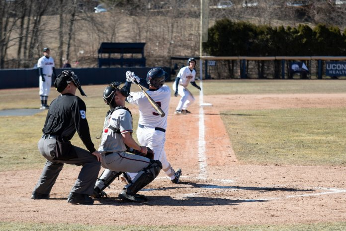 The baseball team won 12-4 against the University of Hartford Tuesday afternoon for their first home game of the season. Michael Woodworth went 2-for-3 with 4 RBIs. (Photo by Nicholas Hampton/The Daily Campus)