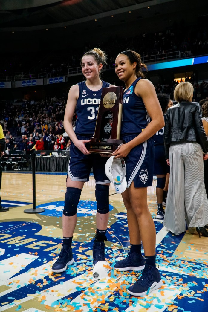 UConn's two seniors Katie Lou Samuelson and Napheesa Collier share the regional championship trophy (Eric Wang/The Daily Campus)