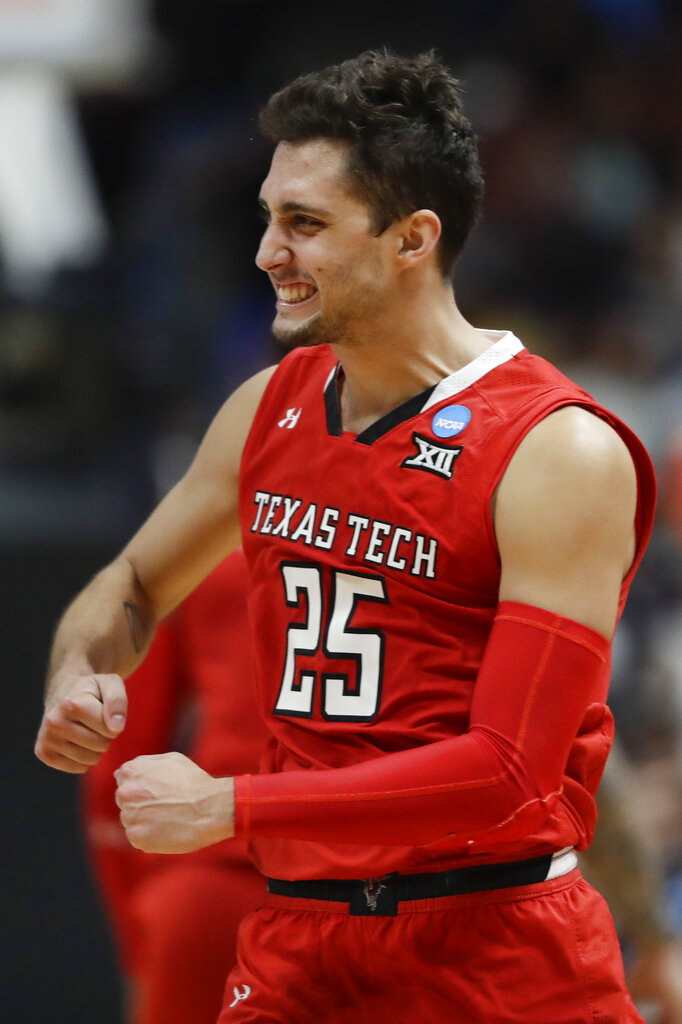 Texas Tech guard Davide Moretti celebrates after scoring against Gonzaga during the second half of the West Regional final in the NCAA men's college basketball tournament Saturday, March 30, 2019, in Anaheim, Calif. (AP Photo/Marcio Jose Sanchez)
