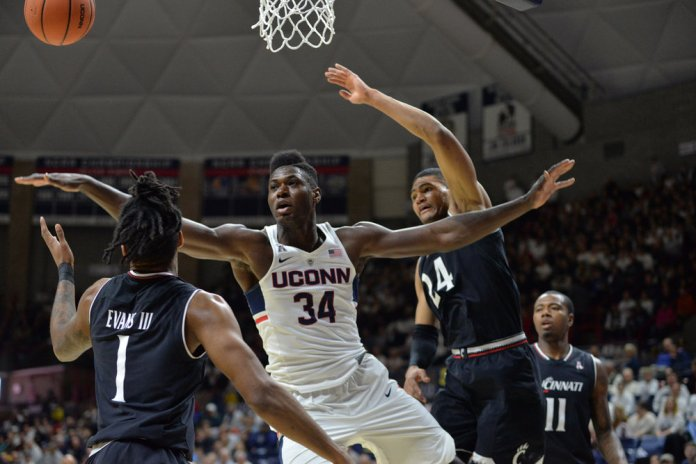 David Onuorah battles for a rebound on the low-post against the Bearcats. (Amar Batra/The Daily Campus)