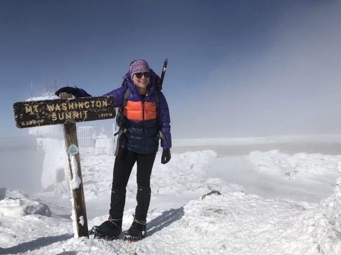 Adventure Center employee, Noelle Albert, climbing Mt. Washington Summit. (via Noelle Albert)