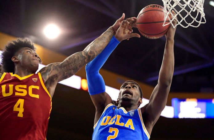 UCLA forward Cody Riley, right, grabs a rebound away from Southern California guard Kevin Porter Jr. during the first half of an NCAA college basketball game in Los Angeles. A recent bill would ensure they got paid.  Photo by Mark J. Terrill/AP