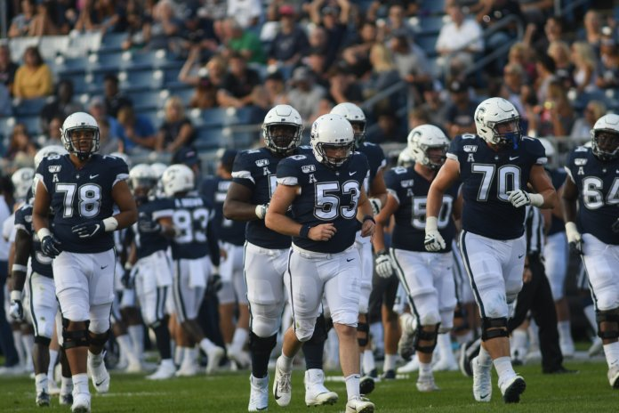 #53 Brian Keating runs onto the field in a game against University of Illinois on September 7.  Photo by Eric Wang / The Daily Campus.