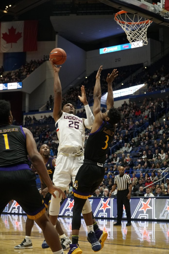 After winning the AAC's Most Improved Player Award, Josh Carlton is also in store for a strong junior year. He is set to start the season at center for the Huskies.  Photo by Eric Wang / The Daily Campus.