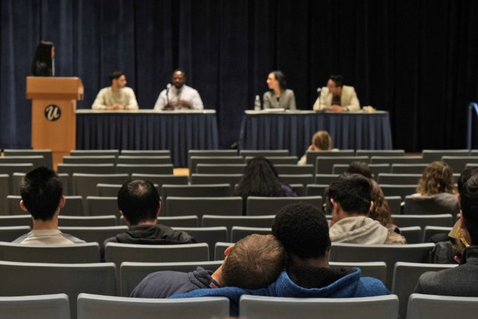 A panel discusses mental health awareness among minority groups in the Student Union Theater on Thursday, Oct. 10.    Photo by Maggie Chafouleas / The Daily Campus