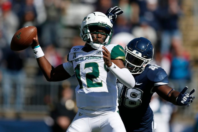 USF is back at .500 after beating BYU 27-23 behind a 158-yard performance from Jordan Conkrite.  Photo from the Associated Press.