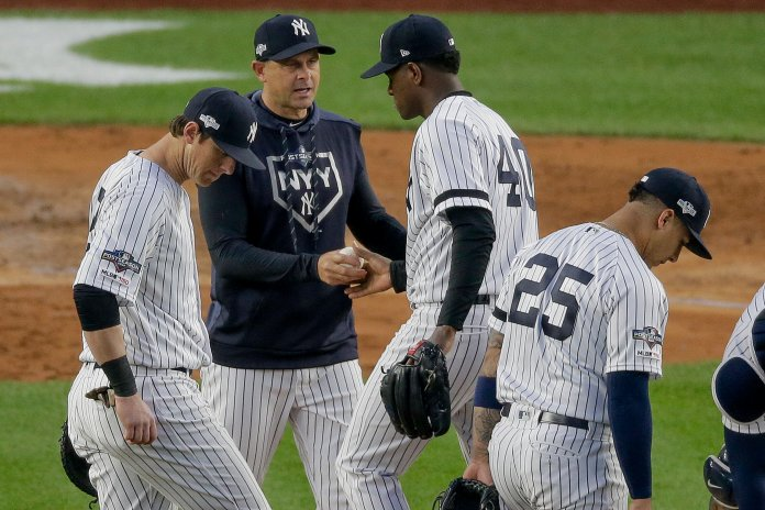 Facing injuries since the beginning of the season, Boone was still able to get the Yankess 100+ wins en route to finishing first in their division.  Photo from the Associated Press.