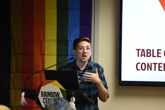 Elliot Ruggles speaks at the Rainbow Center about intimate partner violence. This event is part of the Rainbow Center's Out to Lunch lecture series.  Photo by Brandon Barzola / The Daily Campus