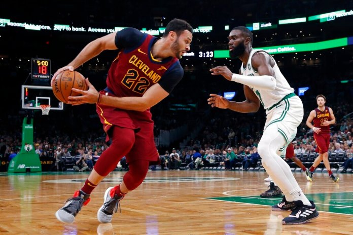 Cleveland Cavaliers' Larry Nance Jr. (22) looks to move against Boston Celtics' Jaylen Brown (7) during the first half of an NBA preseason basketball game in Boston.  Photo by Michael Dwyer/AP