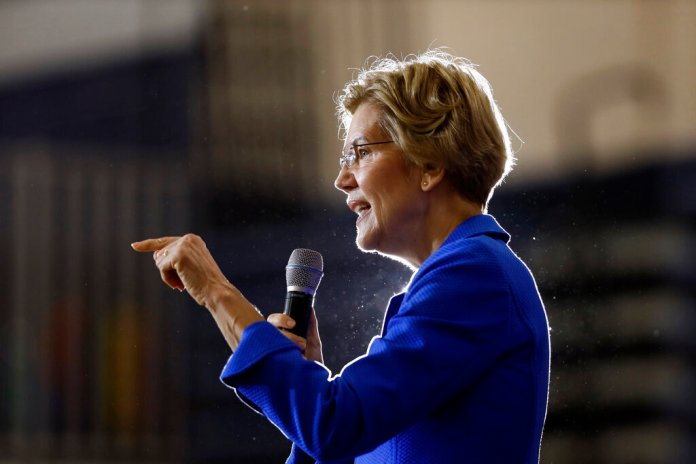 Democratic presidential candidate Sen. Elizabeth Warren, D-Mass., speaks to students and staff at Roosevelt High School, Monday, Oct. 21, 2019, in Des Moines, Iowa.  Photo courtesy of AP Photo/Charlie Neibergall.