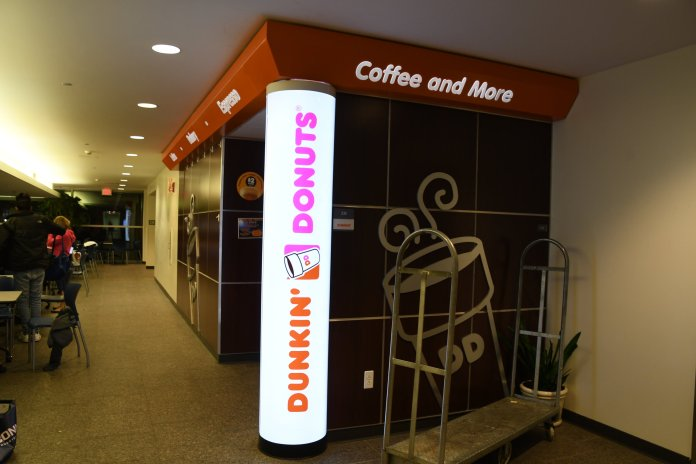 Students purchase coffee and donuts at the Dunkin' Donuts in the upper level of the Student Union. The coffee shop is getting remodeled to allow for more space - a consistent concern with the current set up particularly during rush times.  Photo by Julie Spillane/The Daily Campus