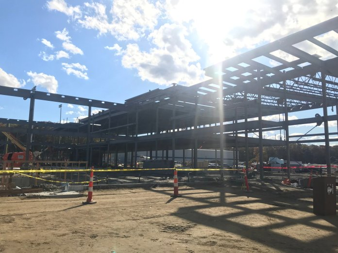 The final beam was set in the Rizza Family Performance Center earlier this week, putting the uinversity one step closer to completing another huge project.  Photo by Conner Gilson / The Daily Campus.