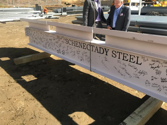 The beam was signed by the baseball, softball and men's and women's soccer and lacrosse teams before finding it's place in the framework.  Photo by Conner Gilson / The Daily Campus.