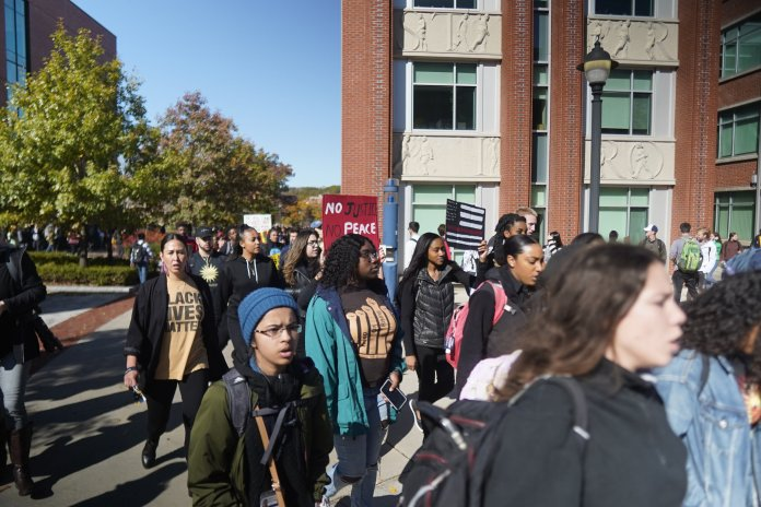 In this photo taken Oct. 21, 2019, UConn Students representing the Black Students Association (BSA), the NAACP of UConn, and other student organizations representing Black students took to the center of campus and marched for their voices to be heard in lieu of recent events of racism.  Photo by Eric Wang/The Daily Campus