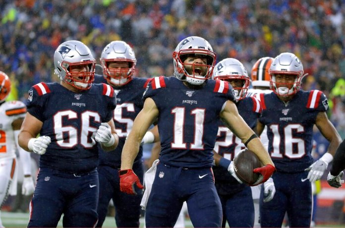New England Patriots wide receiver Julian Edelman, center, celebrates his touchdown catch with teammates in the first half of an NFL football game against the Cleveland Browns, Sunday, Oct. 27, 2019, in Foxborough, Mass.  Photo by Steven Senne/AP