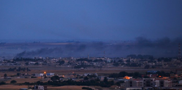 In this photo taken from the Turkish side of the border between Turkey and Syria, in Ceylanpinar, Sanliurfa province, southeastern Turkey, smoke billows from targets in Ras al-Ayn, Syria, caused by shelling by Turkish forces, late Wednesday, Oct. 16, 2019. The U.S. and Turkey agreed Thursday to a five-day cease-fire in the Turks' attacks on Kurdish fighters in northern Syria to allow the Kurds to withdraw to roughly 20 miles away from the Turkish border. The arrangement appeared to be a significant embrace of Turkey's position in the weeklong conflict. (AP Photo/Lefteris Pitarakis)