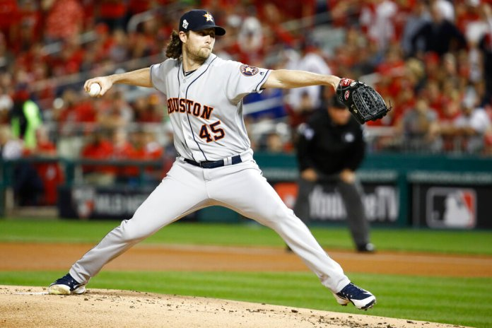Houston Astros starting pitcher Gerrit Cole throws against the Washington Nationals during the first inning of Game 5 of the baseball World Series Sunday, Oct. 27, 2019, in Washington.  Photo by Patrick Semansky/AP