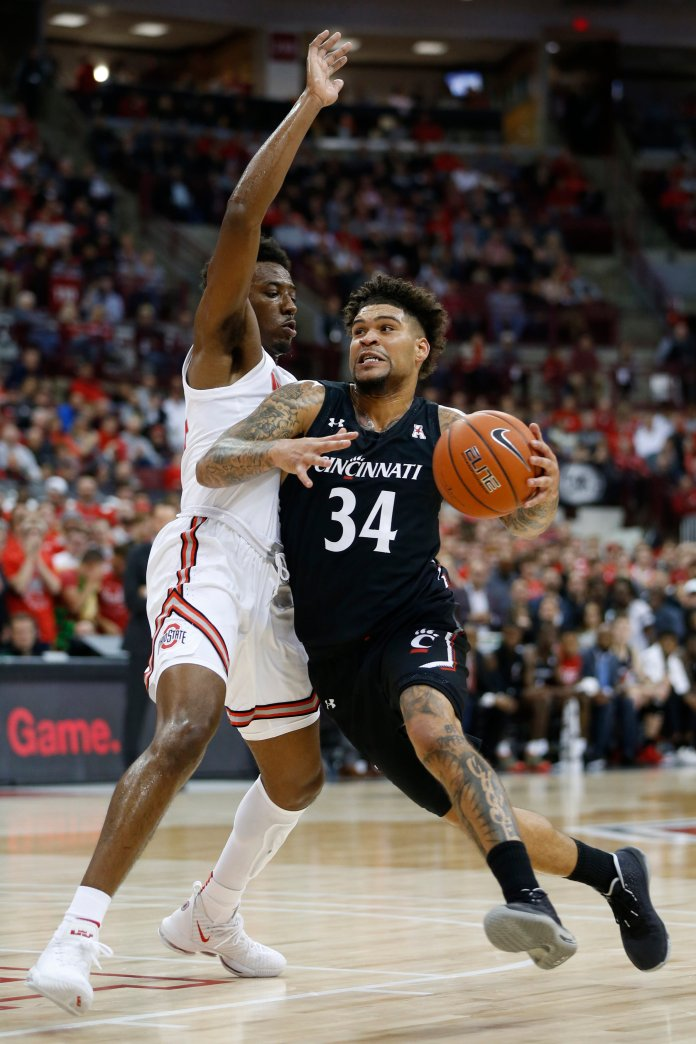 Cincinnati's Jarron Cumberland, right, drives to the basket against Ohio State's Andre Wesson during the first half of an NCAA college basketball game Wednesday, Nov. 6, 2019, in Columbus, Ohio. We predict he will get Player of the Year.  Photo courtesy of Jay LaPrete/The Associated Press
