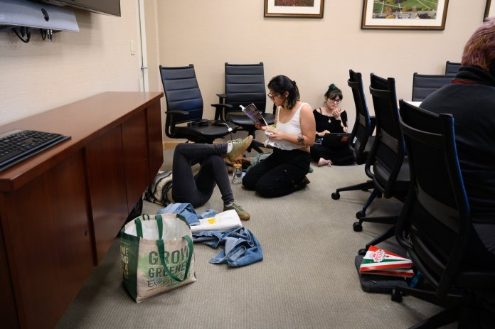 Members of the environmental activism group Fridays For Future stage a sit-in in Gulley Hall for the third week in a row on Friday, Oct. 18, 2019. The group's recent strike Friday at noon took place at the university seal.  Photos by Maggie Chafouleas / The Daily Campus.
