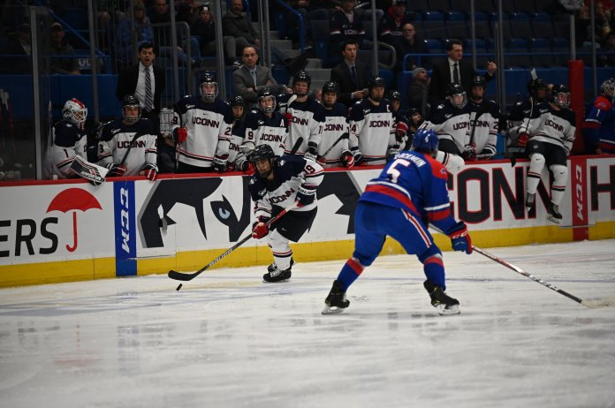 """UConn Men's Hockey ties No. 12 UMass Lowell 3-3 in the XL Center Friday night. The Huskies found their rhythm and took 32 shots during the match. """"I thought our team did a great job all night,"""" Wyatt Newpower said.  Photo by Kevin Lindstrom/The Daily Campus"""