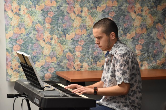 UConn students showcase their talents at the annual Open Mic Night hosted by HARCo Friday, Nov. 15, 2019. Volunteers sang, played the keyboard, and strummed the guitar in the Buckley Classroom.  Photos by Molly Potter / The Daily Campus.