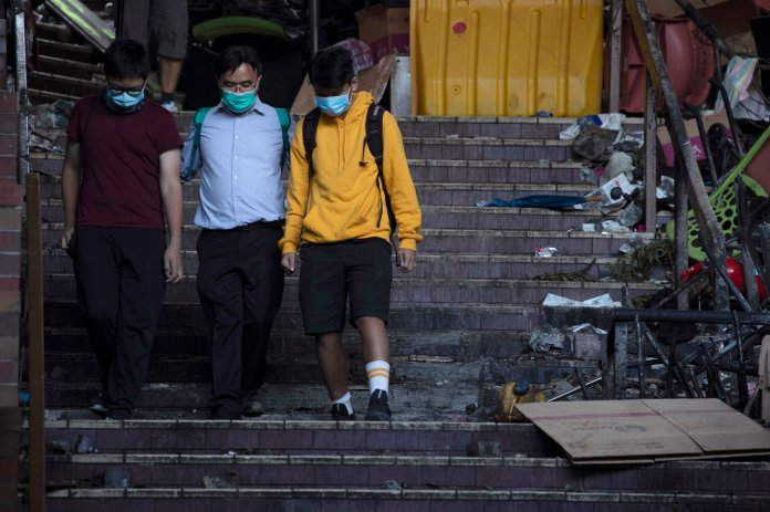 The social rage of Hong Kong's younger generation, coupled with the peer pressure students face, has escalated the protests to violent riots.  Photo from the Associated Press.