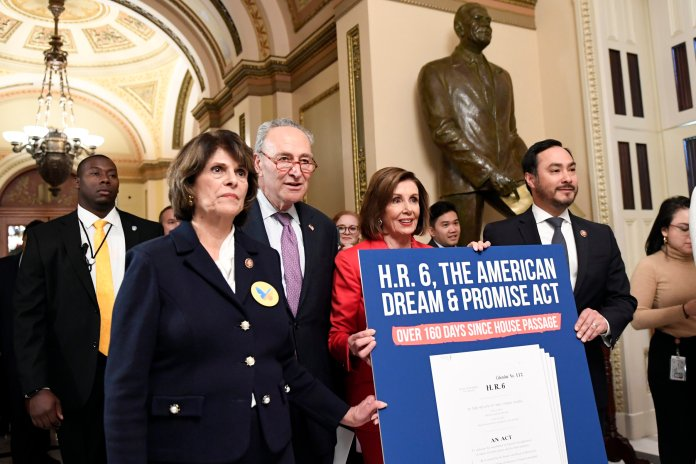 House Speaker Nancy Pelosi of Calif., second from right, joined by, from left, Rep. Lucille Roybal-Allard, D-Calif., Senate Minority Leader Sen. Chuck Schumer of N.Y., and Rep. Joaquin Castro, D-Texas, Chairman of the Congressional Hispanic Caucus, carry a sign as they walk on Capitol Hill in Washington, Tuesday, Nov. 12, 2019, following an event regarding the earlier oral arguments before the Supreme Court in the case of President Trump's decision to end the Obama-era, Deferred Action for Childhood Arrivals (DACA), program. The DACA program sparked divided opinions among UConn students.  AP Photo/Susan Walsh