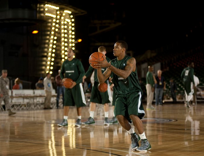 Michigan State University basketball player Keith Applinging practices in the basketball arena on the flight deck aboard Nimitz-class aircraft carrier USS Carl Vinson.  Photo via James R. Evans in the    public domain
