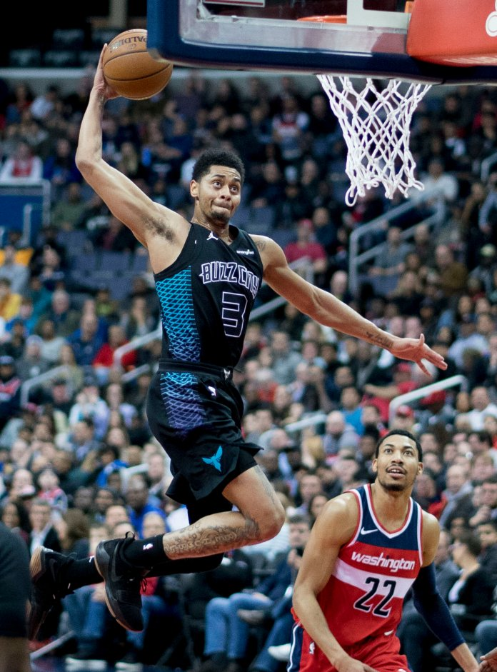 Jeremy Lamb of the Charlotte Hornets dunks against the Washington Wizards on February 23, 2018 at Capital One Arena in Washington, D.C.  Photo via Keith Allison in the    public domain