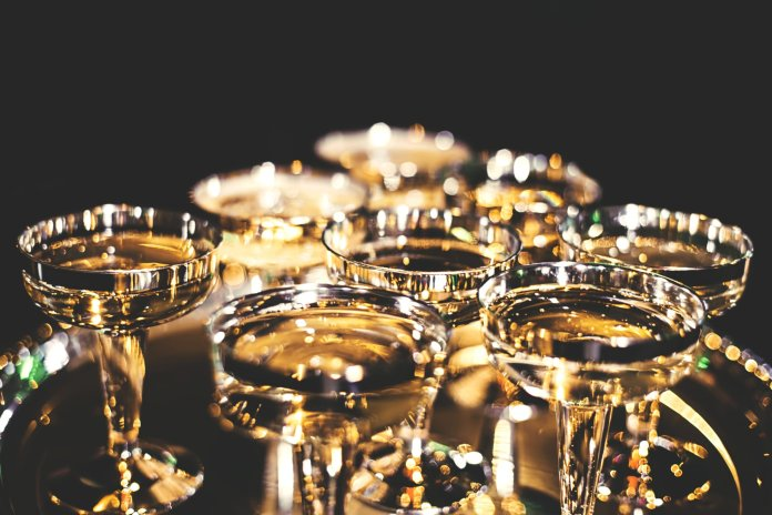 Make your New Year even more special with a fancy drink.  Photo by    Billy Huynh    on    Unsplash   .