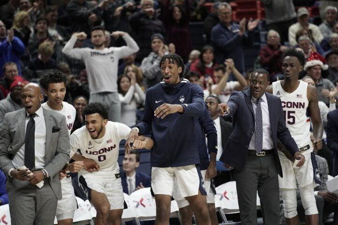 The Huskies won against Iona College with a final score of 80-62. Josh Carlton (25) and Christian Vital (1) lead the team with 19 and 16 points. Their next game will be played on 12/10 at Madison Square Garden against Indiana University.  Photos by Eric Wang / The Daily Campus