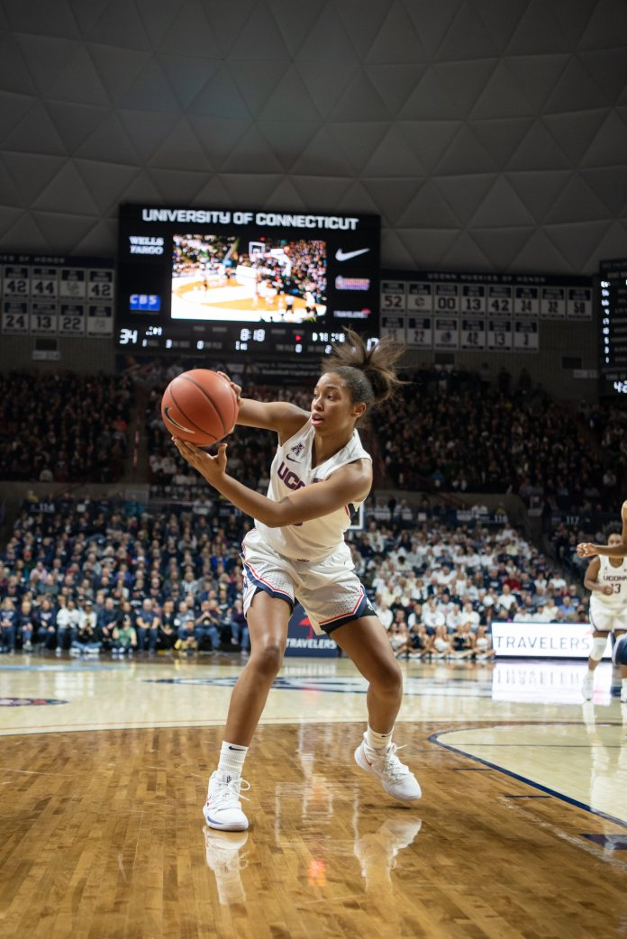 """Megan Walker (3) had nine points and three rebounds with the Huskies beating the Fighting Irish 81-57 Sunday, Dec. 8, 2019. """"We killed it today,"""" Megan Walker said following a win against Oklahoma. Photos by Charlotte Lao / The Daily Campus"""