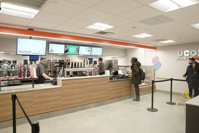 """Dunkin Donuts remodeled their Student Union storefront over winter break with a fresh new sign saying """"UConn Runs On Dunkin.""""  Photo by Eric Wang/The Daily Campus"""