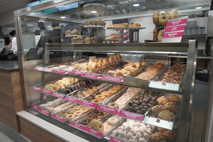 Some new additions to the Dunkin' Donuts includes donuts and bagels in a display case next to the register, as opposed to being behind the counter, and a new tap system for serving drinks.  Photo by Eric Wang/The Daily Campus