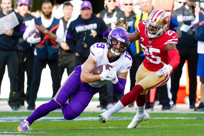 Minnesota Vikings wide receiver Adam Thielen (19) is tackled by San Francisco 49ers cornerback Richard Sherman (25) during the first half of an NFL divisional playoff football game, Saturday. Photo courtesy of Tony Avelar/AP Photo