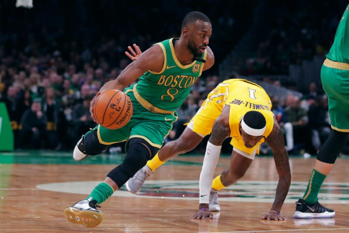 Boston Celtics guard Kemba Walker (8) drives to the basket past Los Angeles Lakers guard Kentavious Caldwell-Pope (1) during the first half of an NBA basketball game in Boston.  Courtesy of Charles Krupa/AP Photo